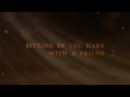 SITTING IN THE DARK WITH A FRIEND