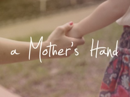 A MOTHER'S HAND TITLE MOTION