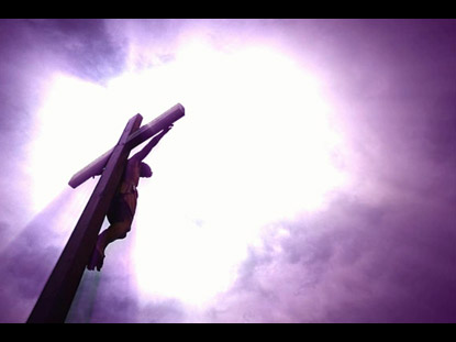 Description seamlessly looping background of christ on the cross with