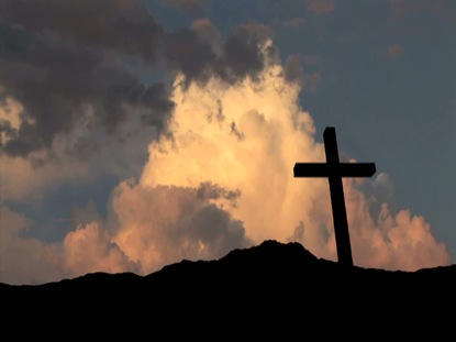 BILLOWING CLOUDS AND A CROSS