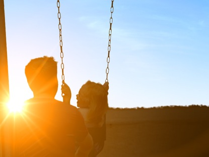 FATHER DAUGHTER SWING SUNSET