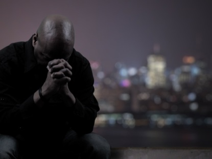MAN PRAYING FOR CITY