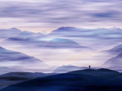 CROSS AND FOG IN THE MOUNTAINS