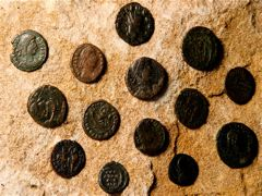ROMAN COINS ON ROCK