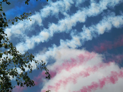 RED WHITE AND BLUE SMOKE TRAILS