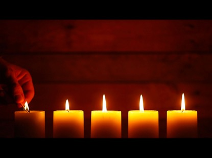 LIGHTING AND BLOWING OUT CANDLES ON A URBAN WOOD BACKGROUND