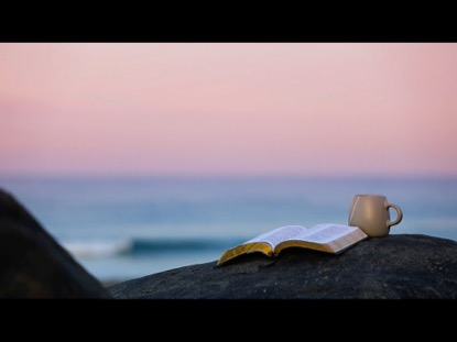 QUIET TIME PINK SUNRISE AT THE BEACH WITH BIBLE AND COFFEE