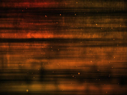 ORANGE GOLD PARTICLE STREAKS