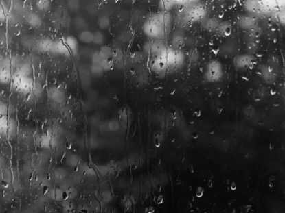 BLACK AND WHITE RAIN DROPS ON WINDOW