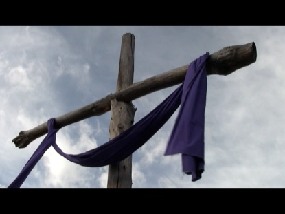 CROSS AND PURPLE CLOTH